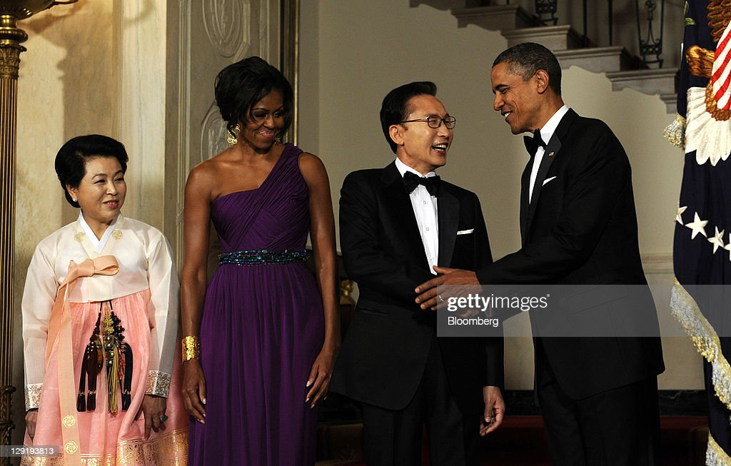 From right, U.S. President <a gi-track='captionPersonalityLinkClicked' href=/galleries/search?phrase=Barack+Obama&family=editorial&specificpeople=203260 ng-click='$event.stopPropagation()'>Barack Obama</a> shakes hands with Lee Myung-bak, president of South Korea, as U.S. First Lady <a gi-track='captionPersonalityLinkClicked' href=/galleries/search?phrase=Michelle+Obama&family=editorial&specificpeople=2528864 ng-click='$event.stopPropagation()'>Michelle Obama</a> and Kim Yoon-ok, First Lady of South Korea, look on in the Cross Hall of the White House before a state dinner in Washington, D.C., U.S., on Thursday, Oct. 13, 2011. Obama said the U.S. has an 'unbreakable' alliance with South Korea as he welcomed the Asian nation's president for a state visit. Photographer: Roger L. Wollenberg/Pool via Bloomberg via Getty Images