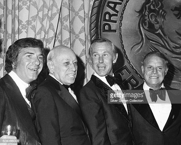 American actor George Raft talk show host Johnny Carson and comedian Don Rickles at the Friars Club Roast of George Raft at the Beverly Hilton Hotel...