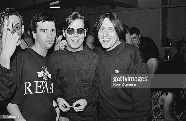 Johnny Marr and Andy Rourke of The Smiths with Shaun Ryder of Happy Mondays at The Hacienda on the night of the club's 8th birthday party Manchester...