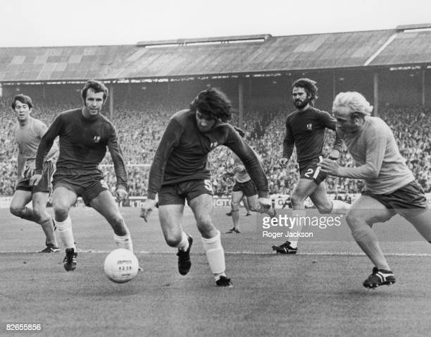 Peter Osgood Paddy Mulligan and David Webb of Chelsea with Alan Whittle of Everton in action during a Charity Shield match at Stamford Bridge London...
