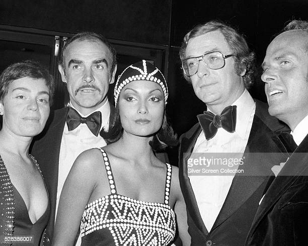 Sean Connery Shakira Caine and Michael Caine at a Premiere Party for 'The Man Who Would Be King' at Nathan's in New York City 16th December 1975