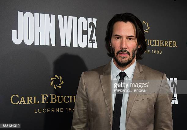 From the cast actor Keanu Reeves poses on arrival for the premiere of the film 'John Wick Chapter Two' in Hollywood California on January 30 2017 /...