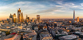Panoramic view over the skyline of London, United Kingdom, during sunset time: from the City to Tower- and London Bridge