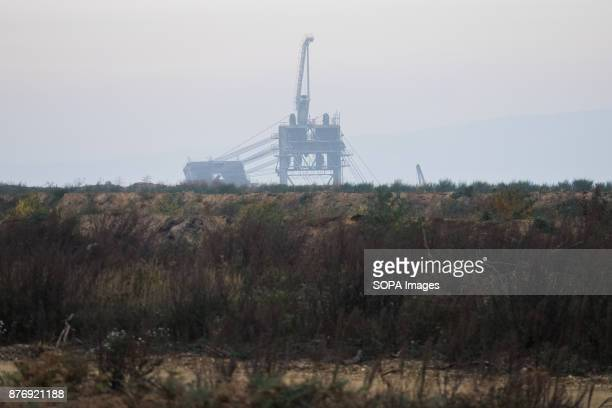 From the forest border the giant excavators of the pit can be seen on the horizon Starting in 2012 the Hambach Forest occupation settlements have...