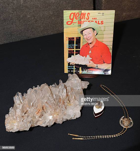 From the former Roy Rogers Museum in Branson Missouri a large smoky Arkansas quartz a fire agate gold ring and a bolo tie with an agatized coral...
