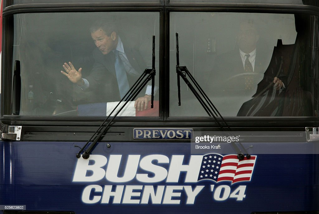 From the front of his campaign bus President George W Bush waves to supporters as he departs after speaking in Lebanon Ohio Bush was on an early...