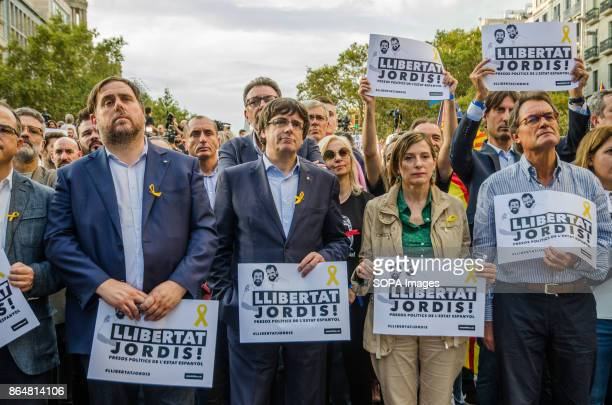 From the left Oriol Junqueras Carles Puigdemont Carme Forcadell and Artud Mas occupy the first row of the demonstration in front of the stage About...