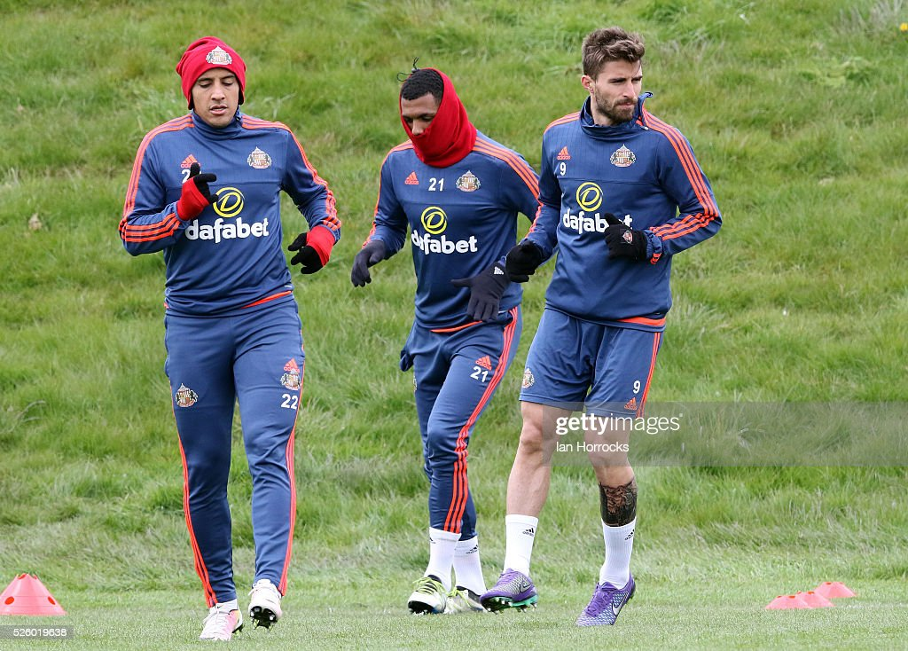 From the left Wahbi Khazri, Yann M'Vila and Fabio Borini jog during a Sunderland AFC training session at The Academy of Light on April 29, 2016 in Sunderland, England.