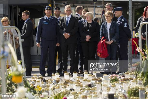 From the middle left the Chief of Turku Police Tapio Huttunen Finland's Prime Minister Juha Sipilae and Finnish parliament member Annika Saarikko...