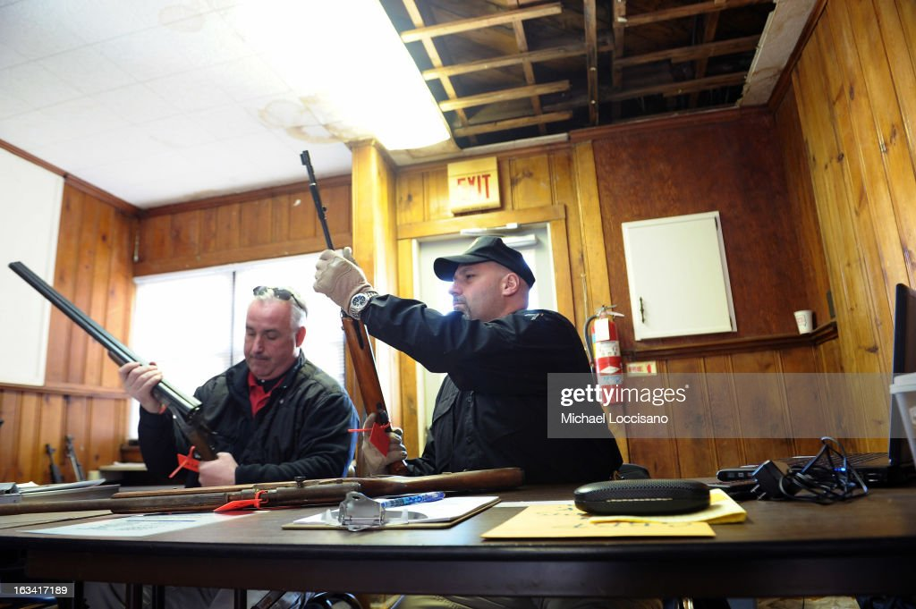 From the Monmouth County Prosecutor's Office Lieutenant Jay Clark (L) and Detective Rocco Santorsola examine firearms during a gun buyback program on March 9, 2013 in Keansburg, New Jersey. In a national effort to curb gun violence, the NJ Attorney General's Office in cooperation with the Monmouth County Prosecutor's Office held an anonymous buyback program where every gun turned in is to be melted down.