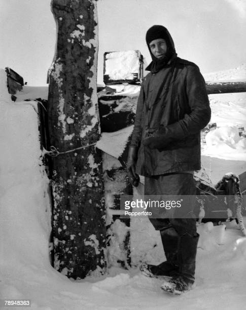 From the Ponting Collection Captain Robert Falcon Scott Photographer Scotts Antarctic Expedition 1910 1912 An expedition team member standing outside...