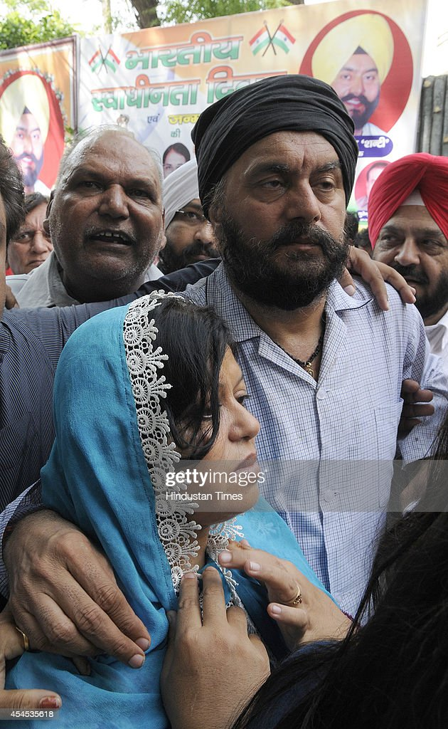 BJP MLA from the Shahdara Jitender Singh Shunty with his wife meets supporters, after he was attacked and shot at by an unidentified man at their house in Vivek Vihar on September 3, 2014 in New Delhi, India. The attacker fired three-four times at Shunty but the MLA managed to escape unhurt.