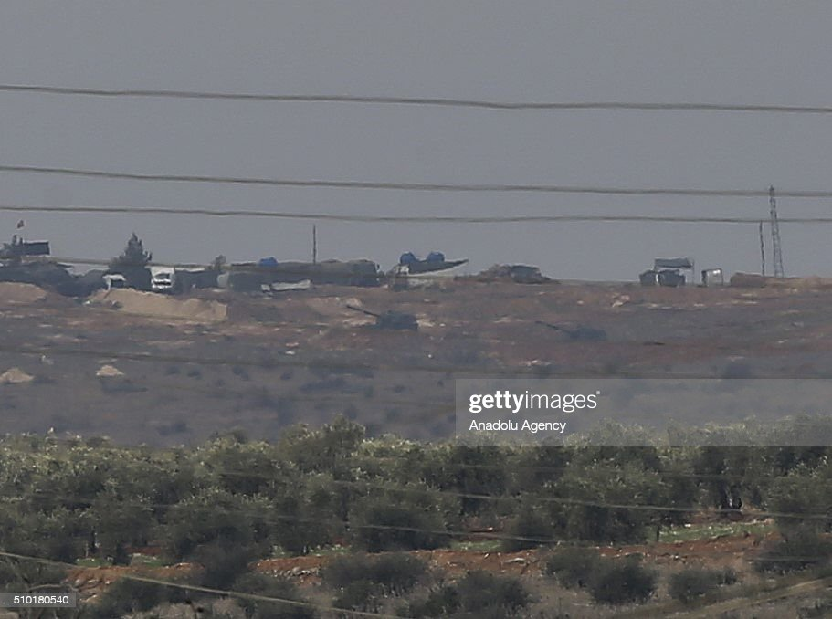 From Turkish side of the Syrian border, Turkish Army howitzers shell YPG terrorists' targets which placed in the Azaz Town of Aleppo, Syria on February 14, 2016. YPG is the armed wing of PYD. The PYD terrorist organization is affiliated to the PKK, a terrorist organization which has fought Turkey since 1984 in a conflict that has caused more than 40,000 deaths. The PKK is listed as a terrorist organization by Turkey, the U.S. and EU.