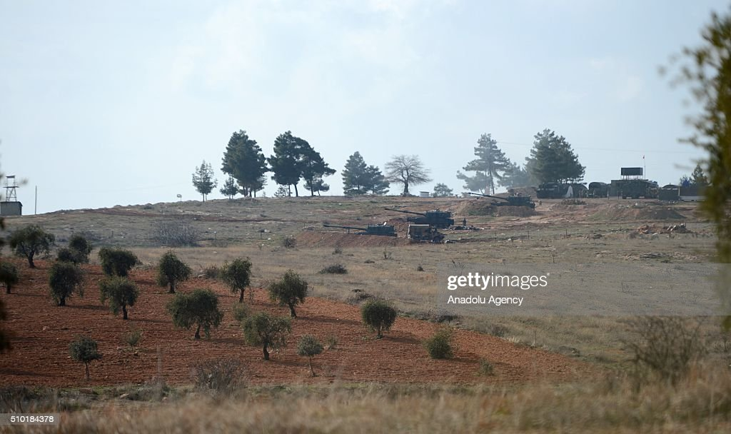From Turkish side of the Syrian border, Turkish Army howitzers shell YPG terrorists' targets which placed in the Azaz Town of Syria's Aleppo, from an emplacement near Syrian border in Turkey's Kilis province on February 14, 2016. YPG is the armed wing of PYD. The PYD terrorist organization is affiliated to the PKK, a terrorist organization which has fought Turkey since 1984 in a conflict that has caused more than 40,000 deaths. The PKK is listed as a terrorist organization by Turkey, the U.S. and EU.