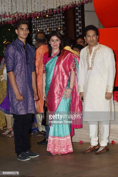 Fromer Cricketer Sachin Tendulkar with wife Anjali and son Arjun during the Ganesh Puja hosted by Mukesh Ambani Chairman of Reliance Industries Ltd...