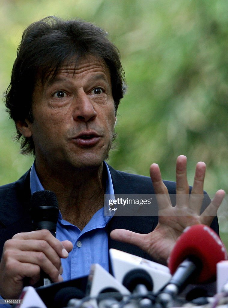 Fromer Pakistan cricketer and leader of Tehreek-e-Insaf Political party, <a gi-track='captionPersonalityLinkClicked' href=/galleries/search?phrase=Imran+Khan+-+Politician&family=editorial&specificpeople=13488792 ng-click='$event.stopPropagation()'>Imran Khan</a> gestures during a press conference in Mumbai, 28 December 2007. Khan who is on a personal visit to India's financial capital mumbai, called for the setting up of a consensus-formed caretaker government and a judicial probe into the assasination of two-time premier Benazir Bhutto, Pakistan's main opposition leader who was killed in a gun and suicide bomb attack ahead of scheduled 08 January elections. AFP PHOTO/Pal PILLAI