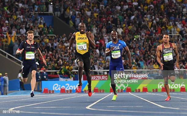 TOPSHOT FromL France's Christophe Lemaitre Jamaica's Usain Bolt USA's Lashawn Merritt and Canada's Andre De Grasse compete in the Men's 200m Final...