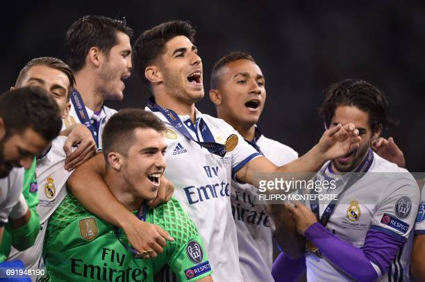 FromL0 Real Madrid's Spanish goalkeeper Ruben Yanez Real Madrid's Spanish midfielder Marco Asensio and Real Madrid's Brazilian defender Danilo...