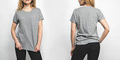front and back view of young woman in blank grey t-shirt isolated on white