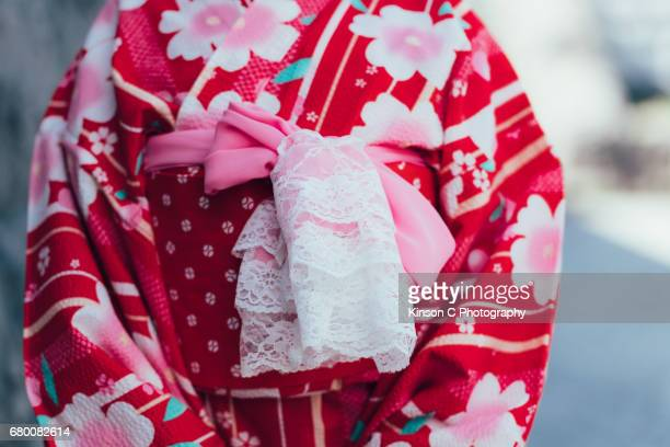 Front closeup of red kimono with pink laced knot