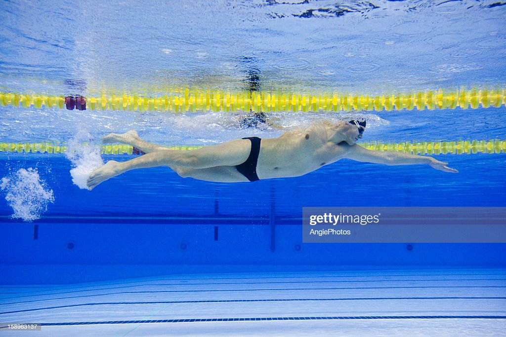 Front crawl swimmer : Stock Photo