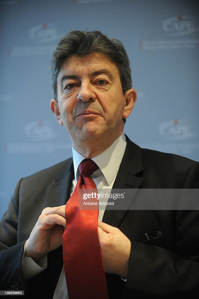 'Front De Gauche' Candidate <a gi-track='captionPersonalityLinkClicked' href=/galleries/search?phrase=Jean-Luc+Melenchon&family=editorial&specificpeople=635097 ng-click='$event.stopPropagation()'>Jean-Luc Melenchon</a> adjusts his tie during a press conference at Centre d'Accueil de la Presse Etrangere on February 14, 2012 in Paris, France. France will go to the polls on April 22, 2012 to elect their new president.