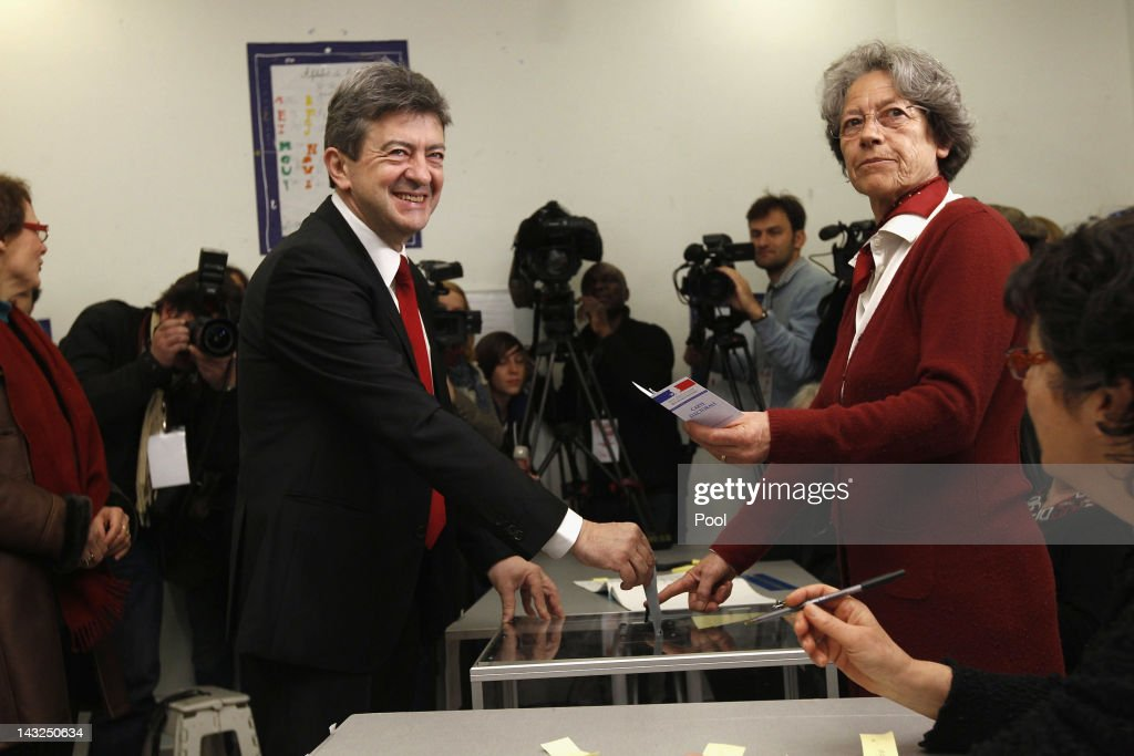 Front de Gauche candidate Jean-Luc Melenchon (L) votes during the first round of the 2012 French Presidential election on April 22, 2012 in Paris, France. French citizens are heading to the polls to vote today in France for the first round of the presidential election, with the two finalists facing off in the second round on May 6.