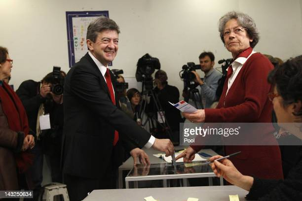 Front de Gauche candidate JeanLuc Melenchon votes during the first round of the 2012 French Presidential election on April 22 2012 in Paris France...