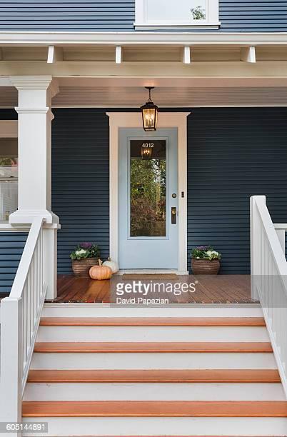 Front door and steps to traditional style home