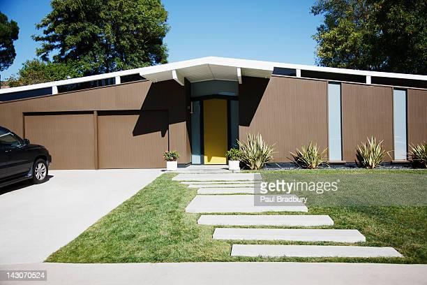 Front door and walkway of modern house