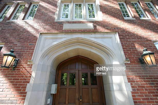 Front door of brick building on college campus