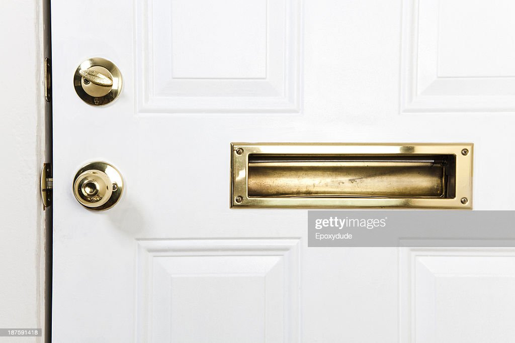 A front door with mail slot doorknob and deadbolt lock : Stock Photo