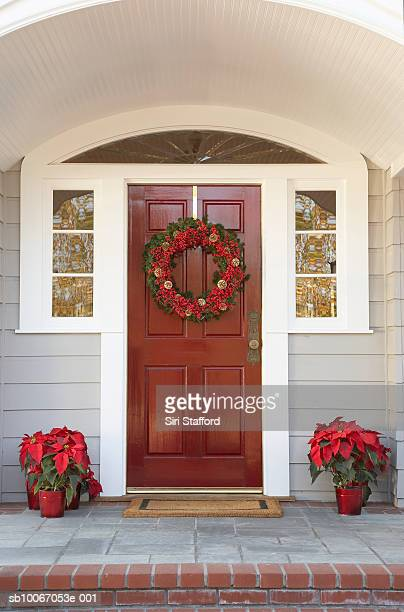 Front door with wreath and poinsettias decoration