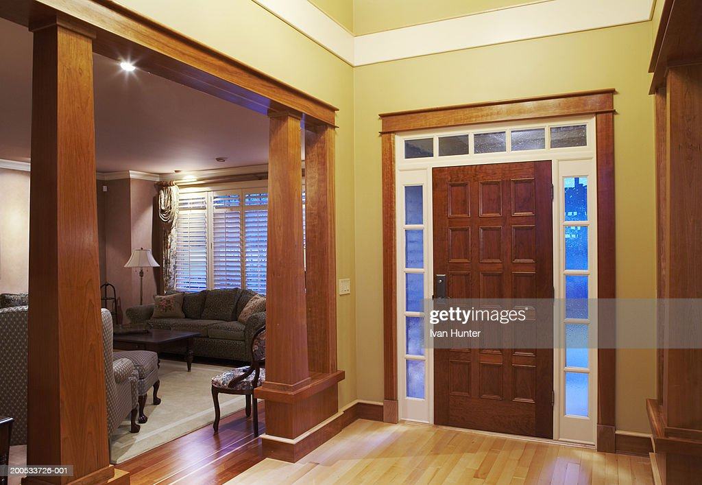 Front Doorway Entrance Hall And Living Room In House Dusk Stock Photo