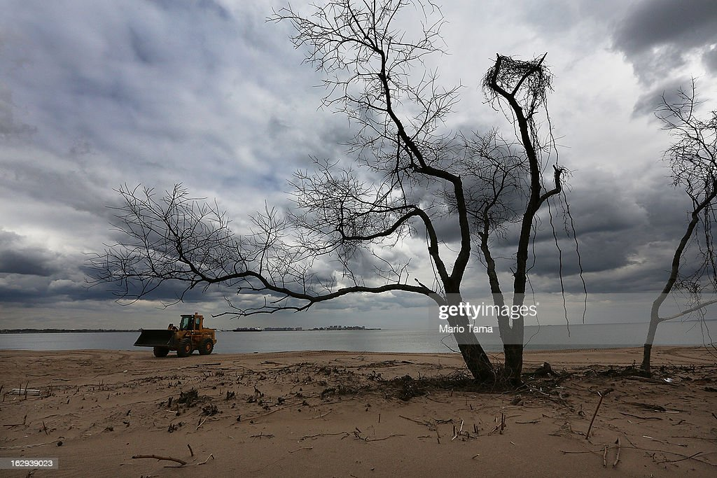 A front end loader is used to clean a still-closed beach area damaged by flooding from Hurricane Sandy on March 1, 2013 in the Staten Island borough of New York City. A government plan to purchase properties in Staten Island damaged by the storm remains on track.