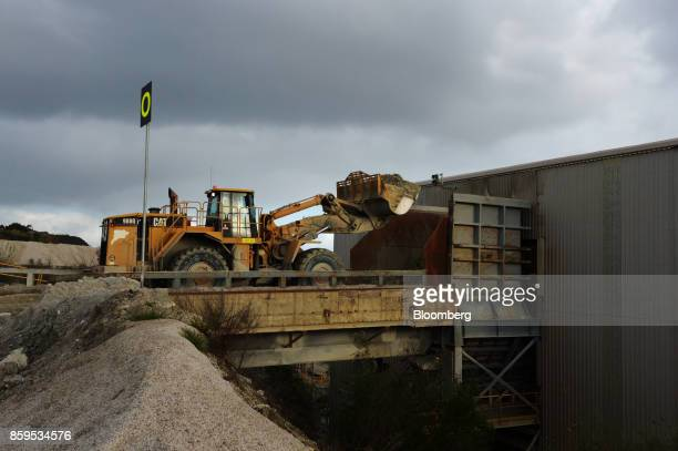 A front end loader operates at a Talison Lithium Ltd site a joint venture between Tianqi Lithium Corp and Albemarle Corp in Greenbushes Australia on...