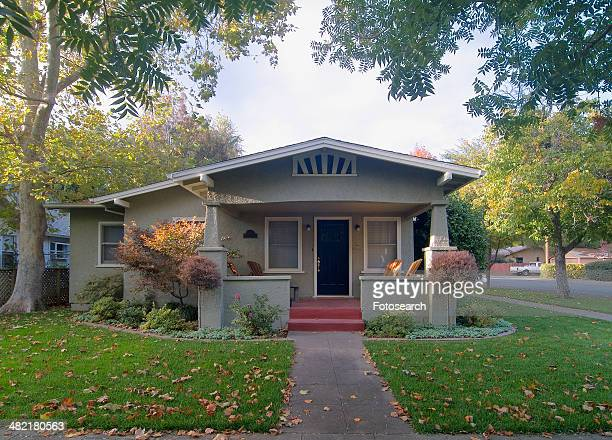 Front exterior view of a green bungalow