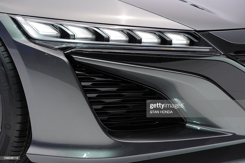 Front light and air scoop detail on the Nissan NSX concept high performance car on display at the 2013 North American International Auto Show in Detroit, Michigan, January 15, 2013. AFP PHOTO/Stan HONDA