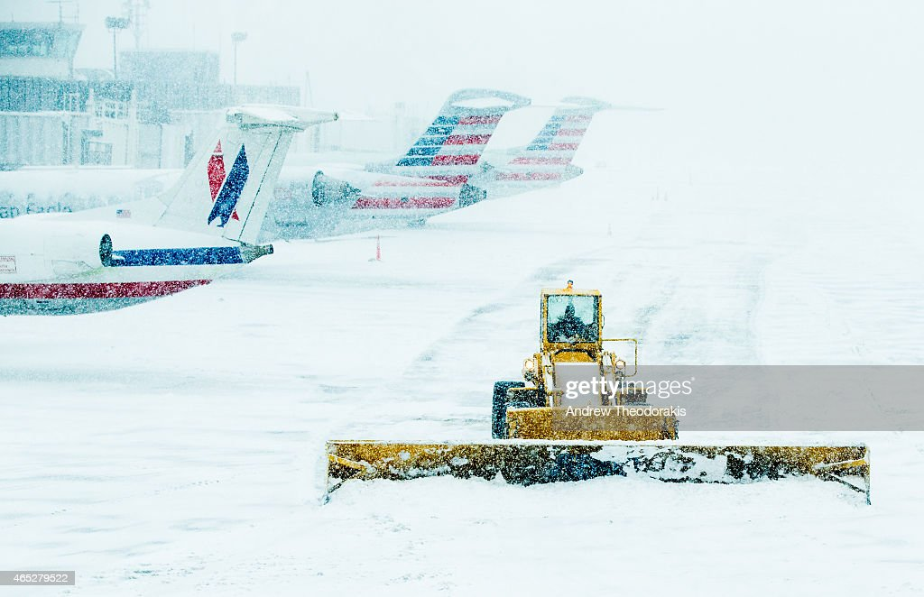 A front loader plows snow March 5 2015 at LaGuardia Airport in the Queens borough of New York City A Delta jet partially skidded off a runway at the...
