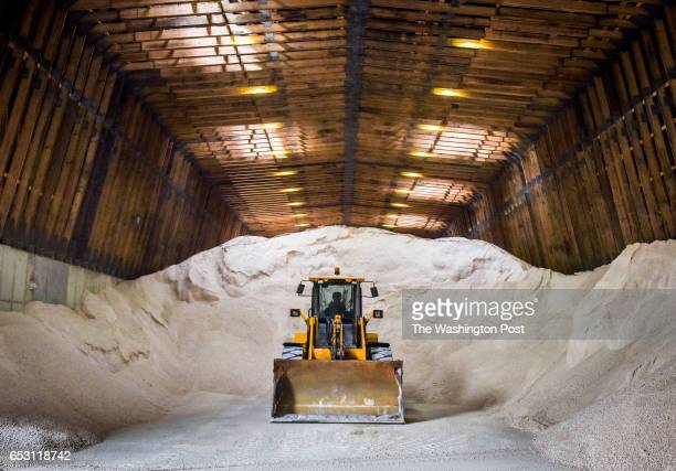 A front loader waits amidst piles of rock salt during preparations for the predicted snowstorm on March 2017 in Washington DC