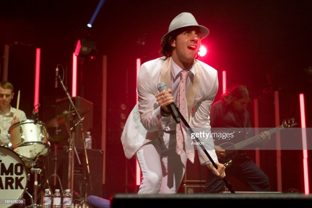 Front man Paul Smith struts the stage in a white suit as Maximo Park play live at the Brixton Academy, London, 6th October 2006.