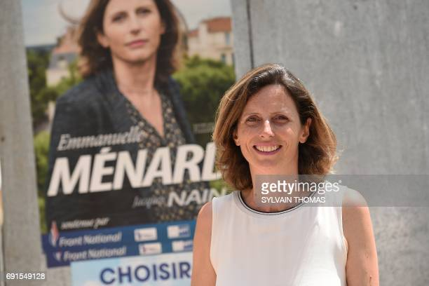 Front National farright party's candidate for the upcoming legislative elections in the Hérault sixth constituency Emmanuelle Menard poses in front...