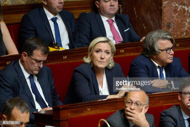 Front National President Marine Le Pen and Front National Louis Alliot and Gilbert Collard react as Ministers answer deputies during the weekly...