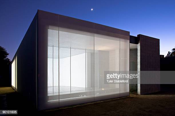 Front of contemporary house at night with moon.