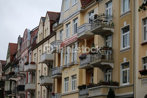 Front Of Old Apartment Buildings Stock Photo