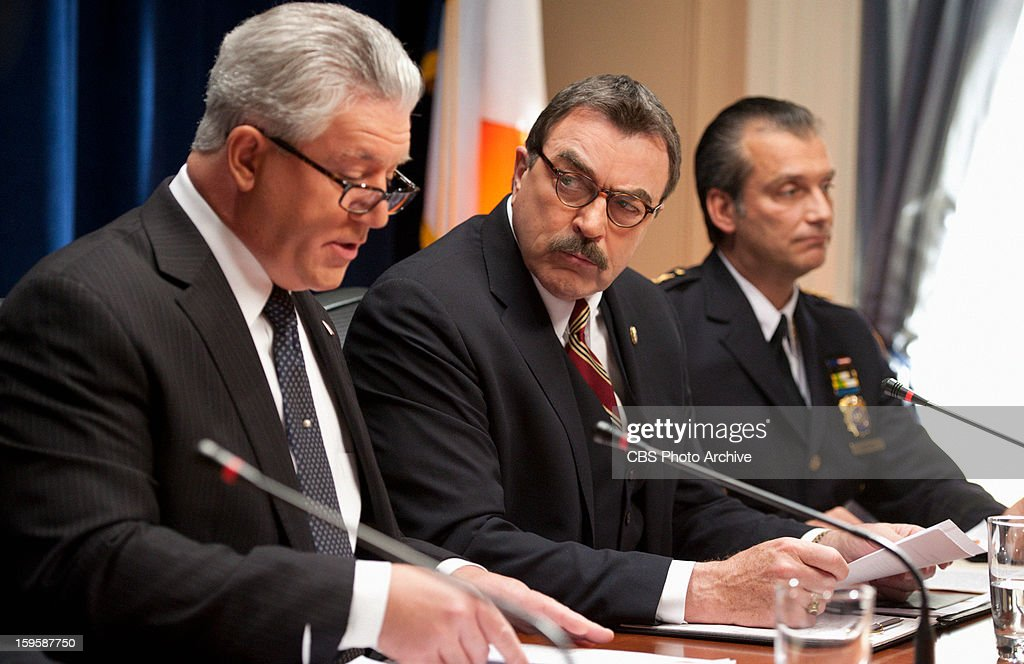 'Front Page News' -- Frank Reagan (Tom Selleck, right), with help from DCPI Garrett Moore (Gregory Jbara, center) leads a press conference to address an incident involving Jamie, on BLUE BLOODS, Friday, Jan. 11 (10:00-11:00 PM, ET/PT) on the CBS Television Network.