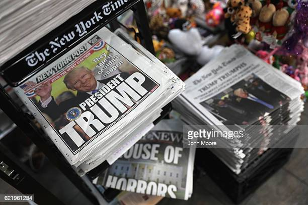 Front pages from New York City newspapers feature Presidentelect Donald Trump on November 9 2016 in New York City Trump is due to meet with President...