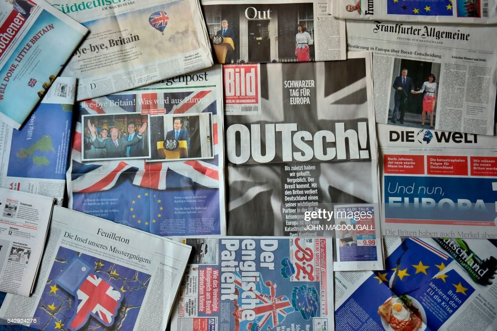 Front pages of German dailies featuring reactions on the so-called 'Brexit' referendum are pictured in Berlin on June 25, 2016. / AFP / John MACDOUGALL