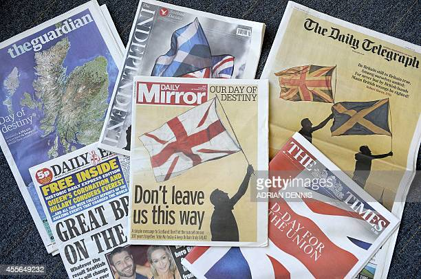 Front pages of the English editions of Britain's national newspapers are pictured in London on September 18 as Scotland votes in a referendum on...