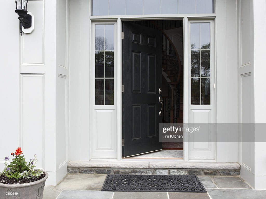 Front porch of house with front door open stock photo getty images